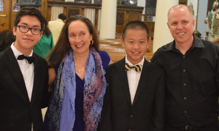 (L–R) Trenton Chang, pianist; Artistic Director/Founder Julie Jordan; Jiayang Jin, pianist; and Conductor Paul Hostetter celebrate their Rachmaninoff and Mozart concerto debuts at St. Gregory the Great Church on June 6.  (Tom Chang)