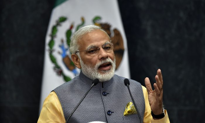 Indian Prime Minister Narendra Modi (L) delivers his press message at the Los Pinos presidential Palace in Mexico City on June 8, 2016. (Yuri Cortez/AFP/Getty Images)