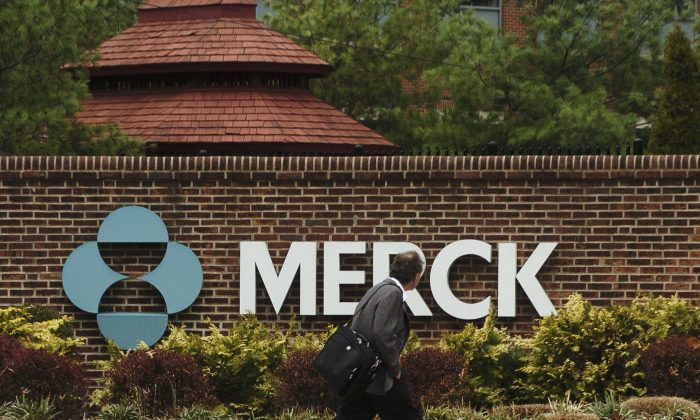 A man walks by a sign at a Merck plant in Rahway, N.J., on Nov. 29, 2005. (Marko Georgiev/Getty Images)