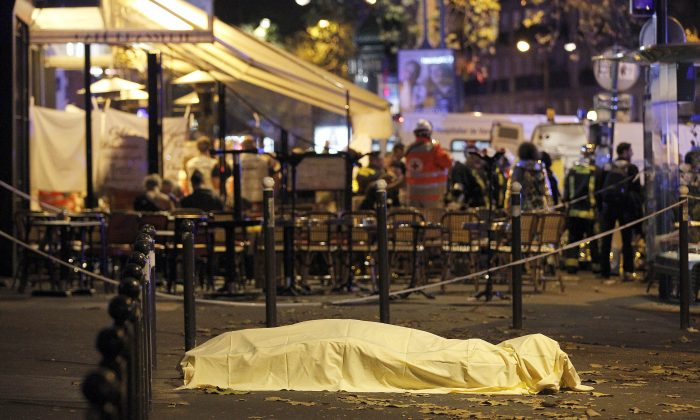 A victim's body lies covered on Boulevard des Filles du Calvaire, close to the Bataclan theater, in Paris, France, on Nov. 14, 2015. According to reports, over 150 people were killed in a series of bombings and shootings across Paris, including at a soccer game at the Stade de France and a concert at the Bataclan theater. (Thierry Chesnot/Getty Images)