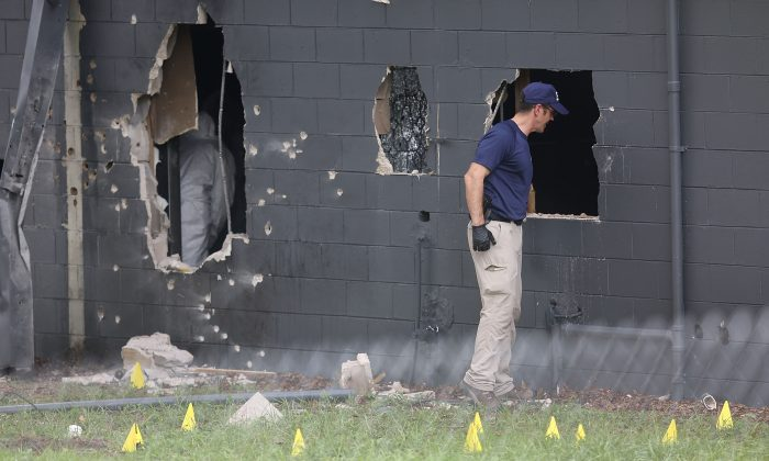 FBI agents investigate the damaged rear wall of the nightclub Pulse, where Omar Mateen allegedly killed at least 50 people in Orlando, Fla., on June 12, 2016. (Joe Raedle/Getty Images)