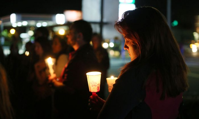 Mourners pay tribute to the victims of the Orlando shooting during a memorial service in San Diego, California on June 12, 2016. (Sandy Huffaker/AFP/Getty Images)