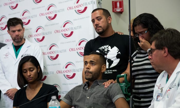 ORLANDO, FL - JUNE 14:  Surrounded by medical personnel and his siblings, Angel Colon, who was injured in the Pulse Nightclub shooting, speaks to the media during a press conference at Orlando Regional Medical Center, June 14, 2016 in Orlando, Florida. The shooting at Pulse Nightclub, which killed 49 people and injured 53, is the worst mass-shooting event in American history. (Photo by Drew Angerer/Getty Images)