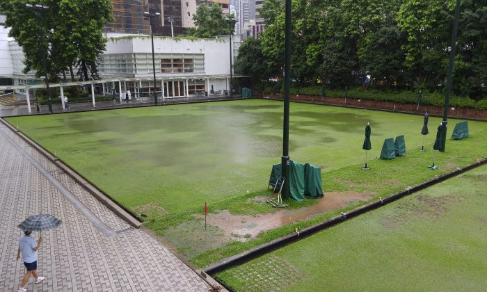 Heavy rain washed away most of the scheduled Premier League games last weekend June 11, 2016. The beautiful Craigengower Cricket Club green became a pond under the downpour. (Sum Lam)