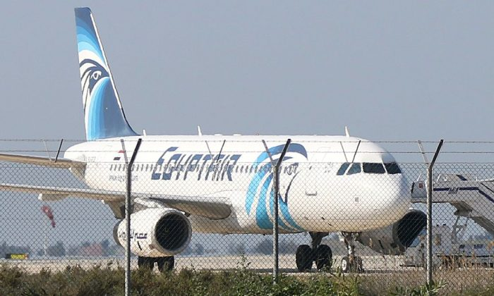 An EgyptAir Airbus A-320 sits on the tarmac of Larnaca airport after it was hijacked and diverted to Cyprus on March 29, 2016. (STR/AFP/Getty Images)