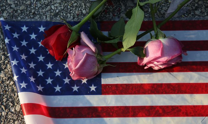 Flowers and an American flag in Orlando, Florida., on June 13, 2016. (Joe Raedle/Getty Images)