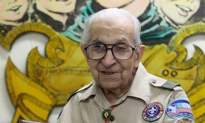 Newark Scoutmaster Julio Balde holds Troop 102's original charter from 1942, in Newark, N.J., on June 11, 2016. (George McNish/NJ Advance Media via AP)