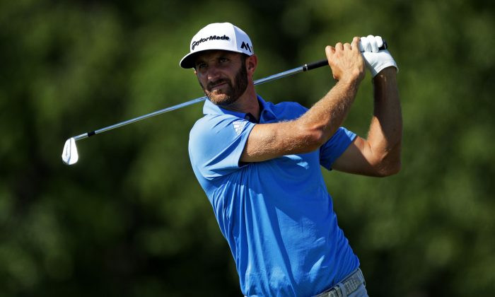 Dustin Johnson plays his shot from the 14th tee during the second round of the U.S. Open at Oakmont Country Club on June 17. (Sam Greenwood/Getty Images)