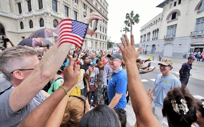 HAVANA, CUBA - MAY 2: American passengers are being welcomed by Cubans upon arriving in Cuba aboard the cruise ship Adonia, the first US cruise ship in nearly forty years to arrive in Cuba, on May 2, 2016, in Havana, Cuba. The Adonia, belonging to the Carnival group, carried some 700 passengers on its sail from Miami to Havana, officially re-establishing the US cruise business in Cuba.(Photo by Sven Creutzmann/Mambo photo/Getty Images)