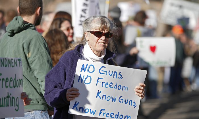 A Second Amendment supporter gathers with other activists in support of gun ownership, at the Colorado Capitol in Denver on Jan. 9, 2013. (Marc Piscotty/Getty Images)