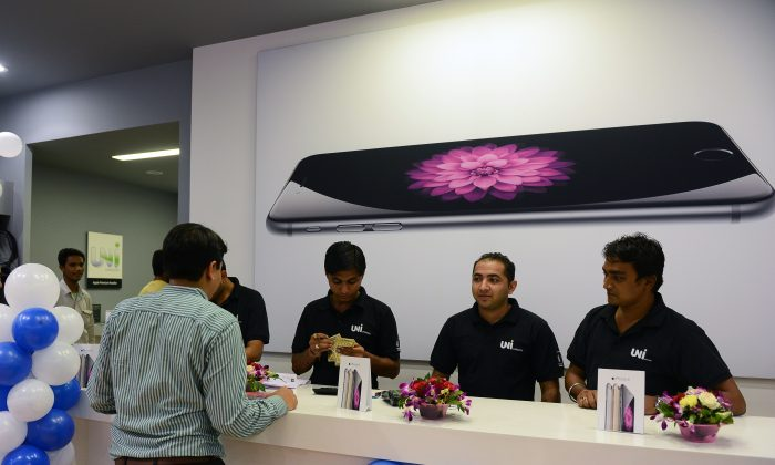 Apple currently sells its products through resellers in India but easing of restrictions may see the company soon opening stores in the world's second most populous nation. (SAM PANTHAKY/AFP/Getty Images)