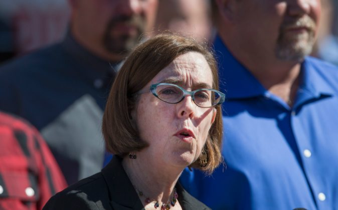 Oregon Gov. Kate Brown speaks to the press in Roseburg, Ore., on Oct. 2, 2015. (Scott Olson/Getty Images)
