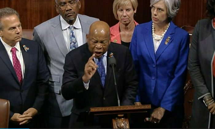 Georgia Rep. John Lewis leads more than 200 Democrats in demanding a vote on measures to expand background checks and block gun purchases by some suspected terrorists in the aftermath of the massacre in Orlando, Florida, that killed 49 people in a gay nightclub on June 12, 2016. (AP Video/Frame Grab)