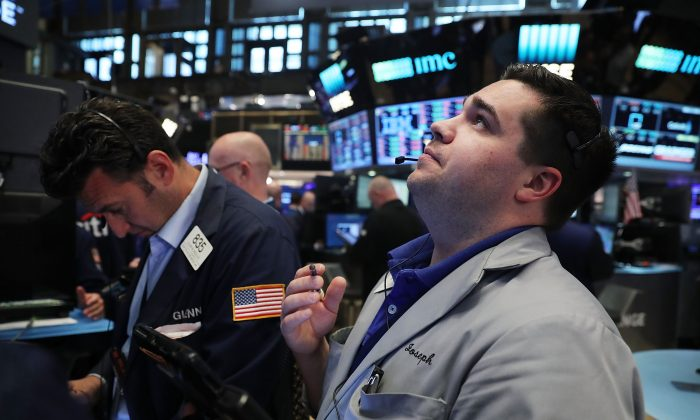 Traders work on the floor of the New York Stock Exchange (NYSE) following news that the United Kingdom has voted to leave the European Union on June 24. (Spencer Platt/Getty Images)