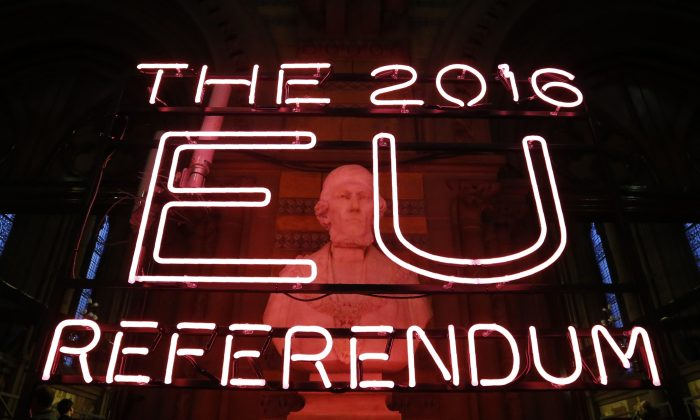 A neon sign for the 2016 referendum is attached to the doors of the announcement hall in Manchester Town Hall, northwest England, on June 23, 2016. (Rob Stothard/AFP/Getty Images)