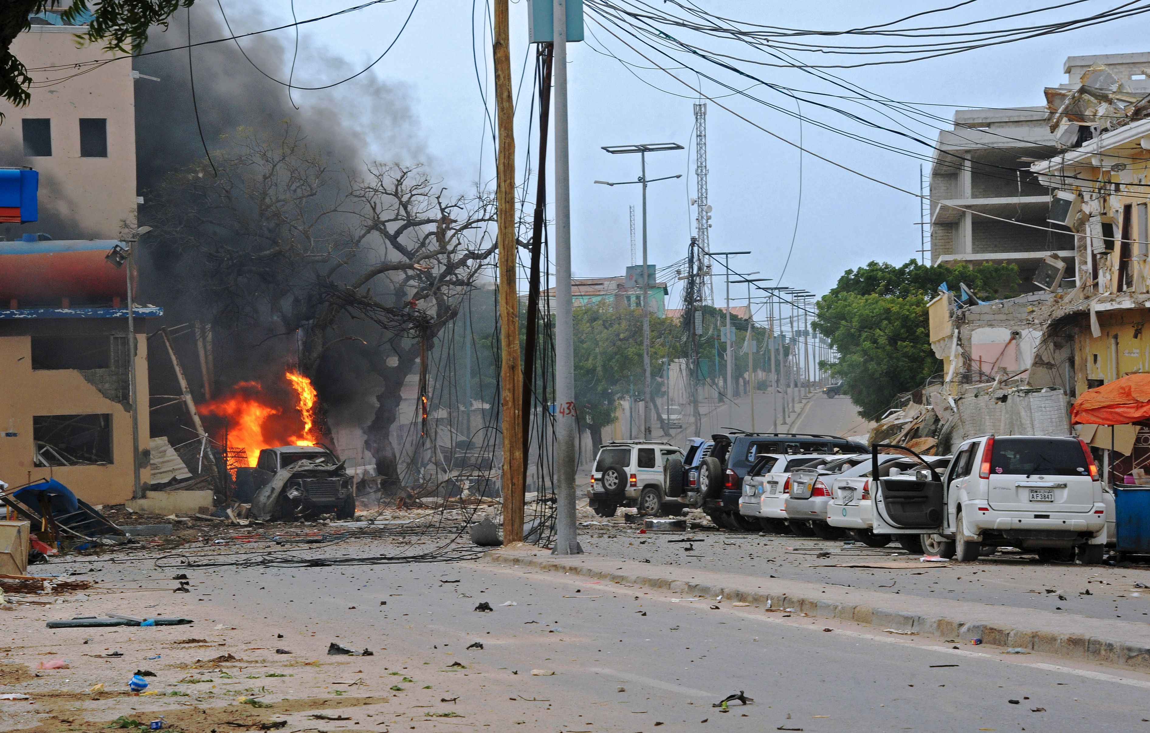 Fire is seen at the scene of a car bomb attack claimed by al-Qaeda-affiliated al-Shabaab militants on the Naasa Hablood hotel in Mogadishu on June 25, 2016. (Mohamed Abdiwahab/AFP/Getty Images)