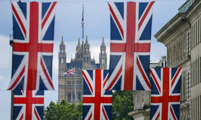 Union flag banners hang across a street near the Houses of Parliament in central London on June 25, 2016. (Odd Andersen/AFP/Getty Images)