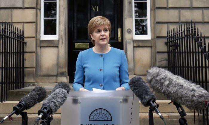 Scottish First Minister Nicola Sturgeon speaks to the media outside Bute House, following an emergency Scottish cabinet meeting in Edinburgh, Scotland, on June 25, 2016. (Jane Barlow/PA via AP)