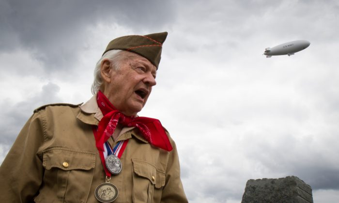 World War II veteran, Rick Carrier, speaks about his life from the war along with what he did after serving in the military on June 5. (Benjamin Chasteen/The Epoch Times)