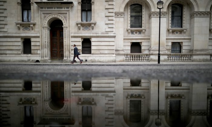 A man walks past government buildings in Whitehall as David Cameron holds his first cabinet meeting since Brexit in London, England, on June 27, 2016. (Christopher Furlong/Getty Images)