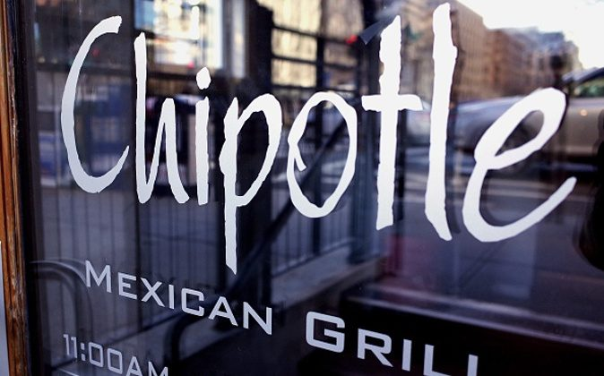 The Chipotle logo is seen on the door of one of its restaurants on January 11, 2015 in Washington, DC. The embattled Mexican fast food chain is under increased scrutiny following outbreaks of foodborn illnesses which lead a decline in share prices. AFP PHOTO/MANDEL NGAN / AFP / MANDEL NGAN (Photo credit should read MANDEL NGAN/AFP/Getty Images)