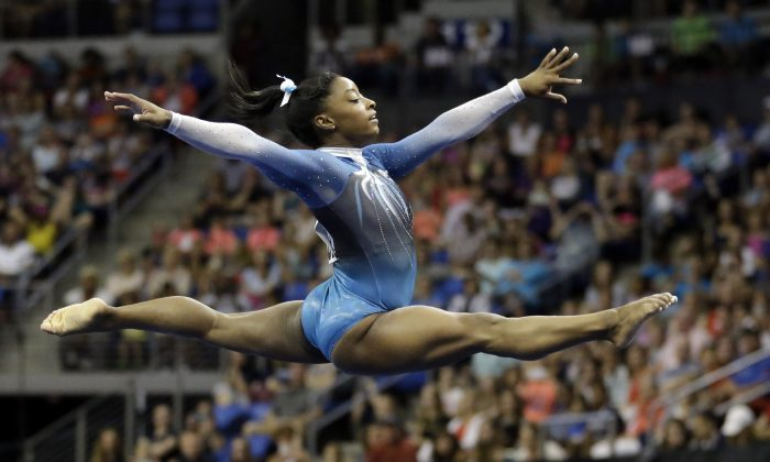 Simone Biles competes in the floor exercise during the U.S. women's gymnastics championship, June 26, 2016, in St. Louis. (AP Photo/Jeff Roberson)