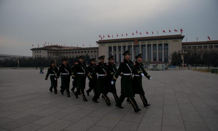 Paramilitary guards walk in Tiananmen Square outside the Great Hall of the People during a press conference of the Chinese People's Political Consultative Conference (CPPCC) on March 2, 2013. (Ed Jones/AFP/Getty Images)