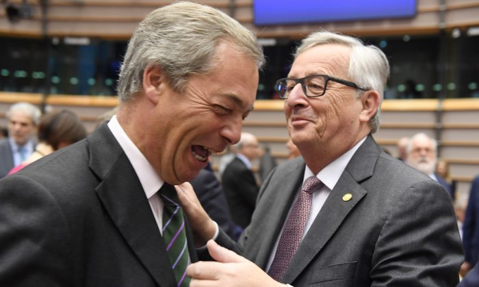 European Commission President Jean-Claude Juncker, right, greets UKIP leader Nigel Farage during a special session of European Parliament in Brussels on June 28, 2016. (AP Photo/Geert Vanden Wijngaert)