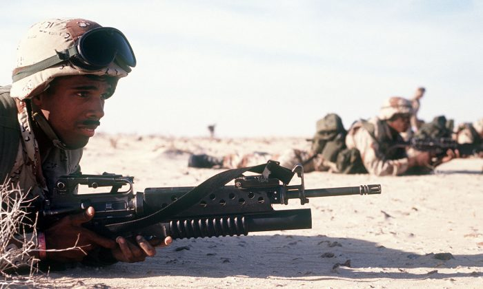 Cpl. Ray Penna guards the camp perimeter with an M-16A2 rifle during an Imminent Thunder training exercise, a part of Operation Desert Shield in 1991. (DOD via Getty Images)