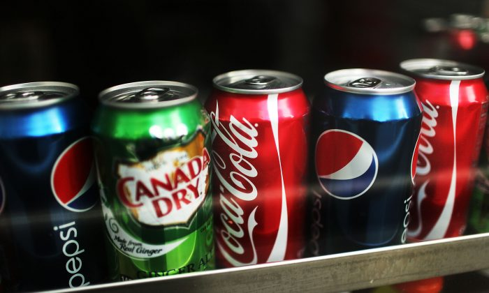 Cans of soda are displayed on a shelf in New York City on Jan. 23, 2013. (Spencer Platt/Getty Images)