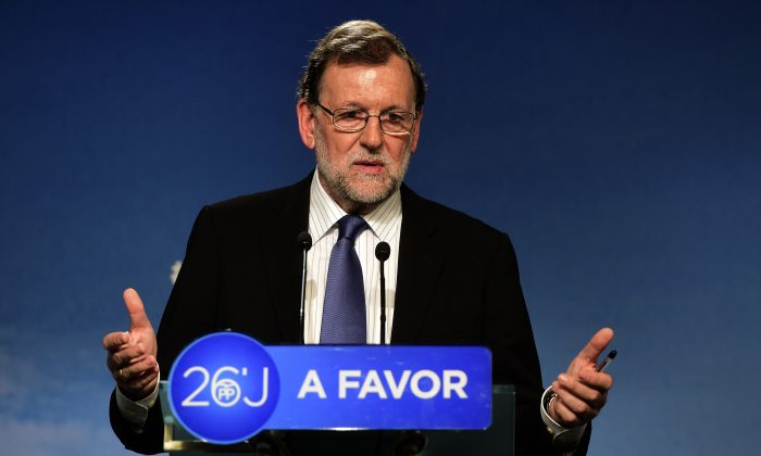 Mariano Rajoy, leader of the Popular Party (PP) and Spain's caretaker prime minister, delivers a speech after a meeting of the national executive committee held one day after the Spanish general elections, at the PP headquarters in Madrid, on June 27, 2016. (Jose Jordan/AFP/Getty Images)