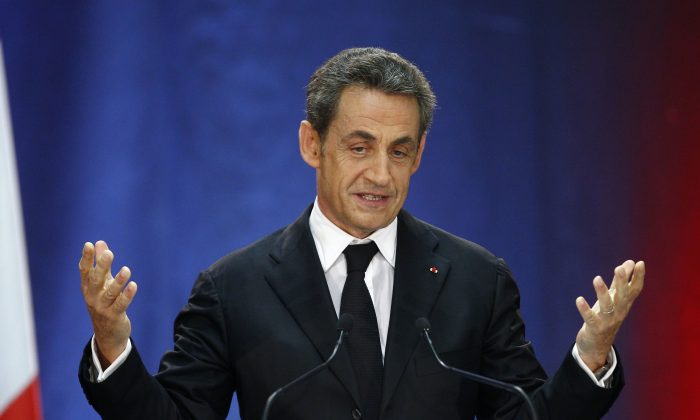 Former French President Nicolas Sarkozy speaks as part of his campaign for the leadership of his conservative UMP party in Lambersart, northern France on Sept. 25, 2014. (AP Photo/Michel Spingler)