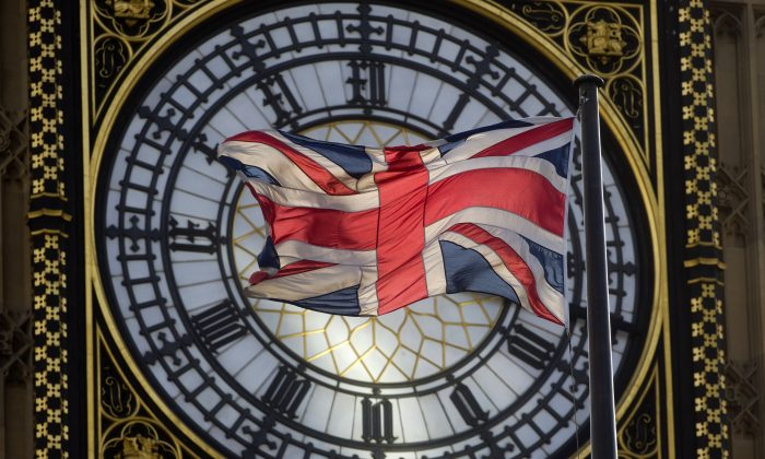 The Union Kingdom flag flaps in the wind in front of the Great Clock atop the landmark Elizabeth Tower that houses Big Ben at the Houses of Parliament in central London on Sept. 26, 2014. (Justin Tallis/AFP/Getty Images)