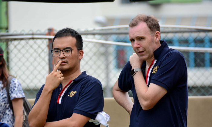 Robin Chok (left) and Derek Wyllie considering their tactics during the National Pairs final 2016 against CCC's Imen Tang and Stanley Lai.  Chok and Wyllie lost the game by one shot and have to settle for runners-up. (Stephanie Worth)