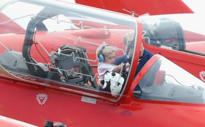 Prince William, Duke of Cambridge with Prince George in the cockpit of a Red Arrow during a visit to the Royal International Air Tattoo at RAF Fairford on July 8, 2016 in Fairford, England. (Chris Jackson/Getty Images)