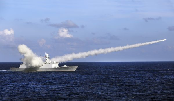Chinese missile frigate Yuncheng launches an anti-ship missile during a military exercise in the waters near south China's Hainan Island and Paracel Islands on July 8, 2016. (Zha Chunming/Xinhua via AP)