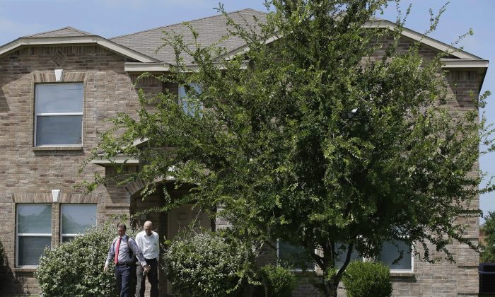 Investigators leave the home of Micah Xavier Johnson in the Dallas suburb of Mesquite, Texas, on July 8, 2016. (AP Photo/LM Otero)