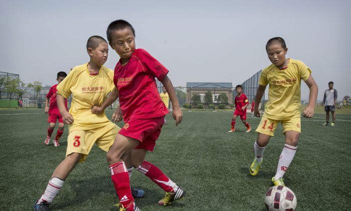 Children play soccer on a practice pitch at the Evergrande International Football School in Guangdong Province, China. (Kevin Frayer/Getty Images)