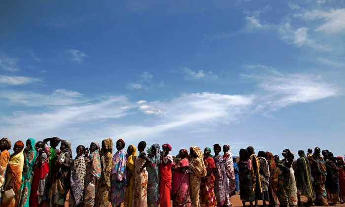 Internally displaced people (IDPs) recently arrived to Wau, South Sudan, due to armed clashes in surrounding villages, wait to be registered by the International Organization for Migration (IOM) and the World Food Program (WFP) on May 11, 2016. (Albert Gonzalez Farran/AFP/Getty Images)