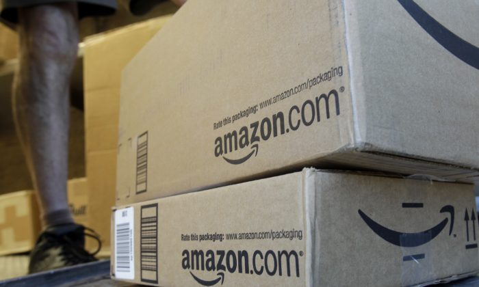 "FILE - In this June 30, 2011 file photo, a United Parcel Service driver delivers packages from Amazon.com in Palo Alto, Calif. Amazon is offering deals July 12, 2016, for the second edition of its annual ""Prime Day"" promotion. (AP Photo/Paul Sakuma, File)"