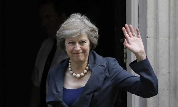 Britain's former Home Secretary and current Prime Minister, Theresa May, as she arrives to attend a cabinet meeting at 10 Downing Street, in London, Tuesday, July 12, 2016. (AP Photo/Kirsty Wigglesworth)