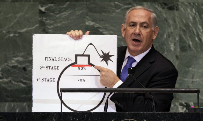 Israeli Prime Minister Benjamin Netanyahu shows an illustration as he describes his concerns over Iran's nuclear ambitions during his address to the 67th session of the United Nations General Assembly at U.N. headquarters, in this file photo. (AP Photo/Richard Drew, File)