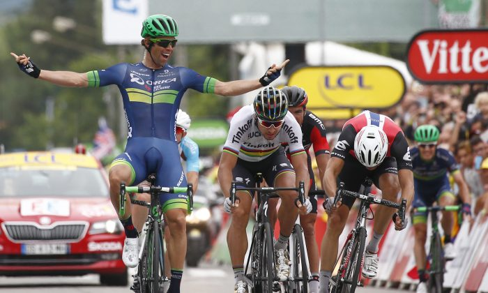 Orica's Michael Matthews, left, celebrates as he crosses the finish line head of Peter Sagan of Tinkoff, center, and Dimension Data's Edvald Boasson Hagen to win Stage Ten of the 2016 Tour de France, 197 kilometers (122.4 miles) from Escaldes-Engordany, Andorra, to Revel, France, Tuesday, July 12, 2016. (AP Photo/Peter Dejong)