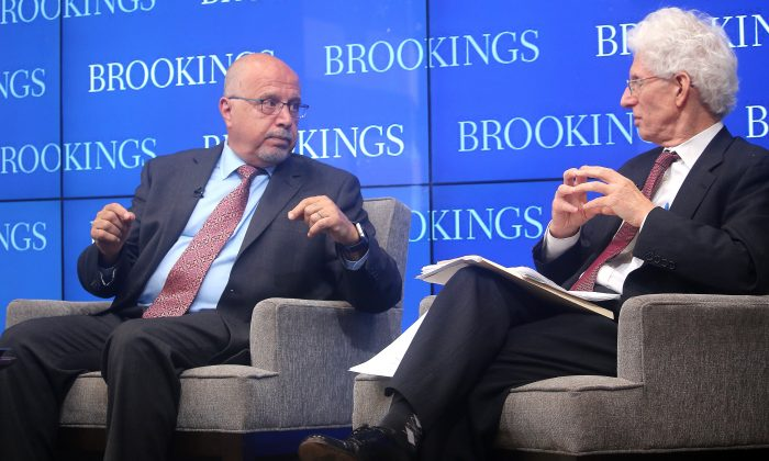 Shibley Telhami (L), nonresident senior fellow, Brookings Institution, and William Galston, senior fellow, Brookings Institution, discuss three public opinion surveys on American attitudes towards the Middle East. One of the surveys was taken two weeks before the Orlando shooting and another survey was taken two weeks after the shooting, thereby providing a measure of the shift in attitudes. (Gary Feuerberg/Epoch Times)