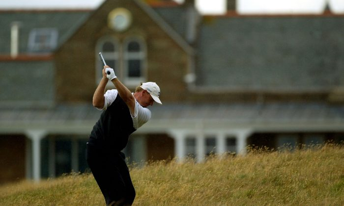 Ernie Els of South Africa plays his approach shot to the 18th green during the third round of the 133rd Open Championship at the Royal Troon Golf Club on July 17, 2004 in Troon, Scotland. (Warren Little/Getty Images)