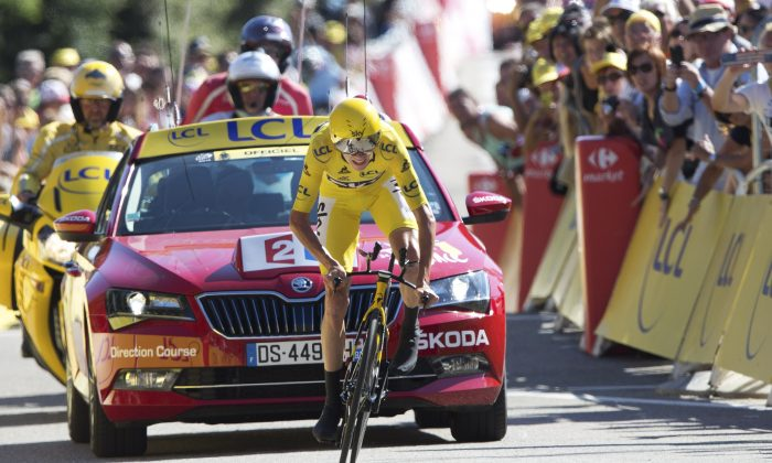 Sky's Chris Froome crosses the finish line of Stage 13 of the 2016 Tour de France, an individual time trial of 37.5 kilometers (23 miles) between Bourg-Saint-Andeol and La Caverne du Pont-d'Arc, France, Friday, July 15, 2016. (AP Photo/Peter Dejong)