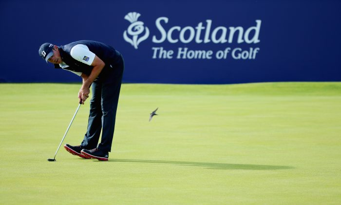 Matt Kuchar reacts to his putt on the 18th green during the second round of the Aberdeen Asset Management Scottish Open at Gullane Golf Club in Gullane, East Lothian, Scotland, on July 10, 2015. (Andrew Redington/Getty Images)