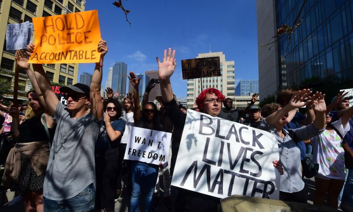 Hundreds gather for a Black Lives Matter rally outside Los Angeles Police Department headquarters on July 12, 2016 in Los Angeles, Calif. (Frederic J. Brown/AFP/Getty Images)
