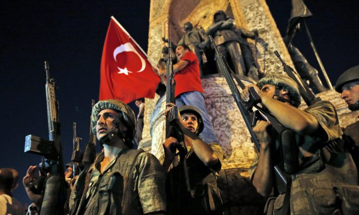 "Turkish soldiers secure the area as supporters of Turkey's President Recep Tayyip Erdogan protest in Istanbul's Taksim square, early  July 16, 2016. "" (AP Photo/Emrah Gurel)"