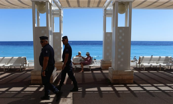Police patrol near the scene of a truck attack on the famed Promenade des Anglais in Nice on July 16. (AP Photo/Francois Mori)